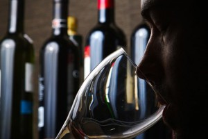 Man intently smelling wine in Napa Valley