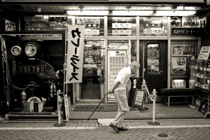 Old man walking street in Tokyo, Japan (black and white)