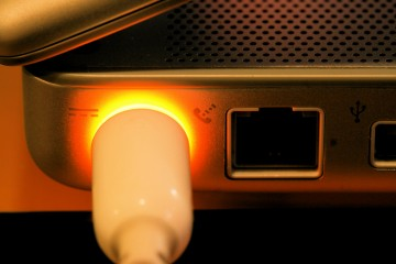 Orange Glow of a Laptop Power Cable