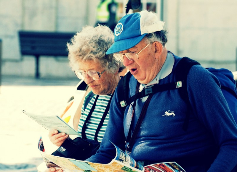 Old, Over-prepared Tourist Couple