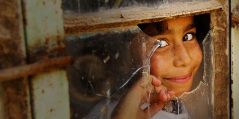 Girl Peeking Out Classroom Window, Iraq