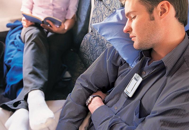 Sleeping man wearing Personal Air Purifier