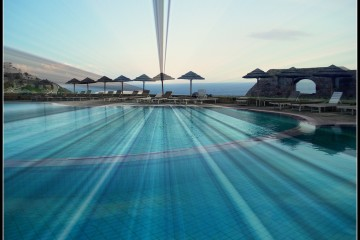 Pool at the famous Royal Myconian Hotel in Elia Beach, Mykonos, Greece