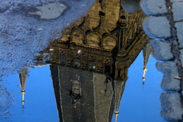 Reflection of Prague in Blue Puddle