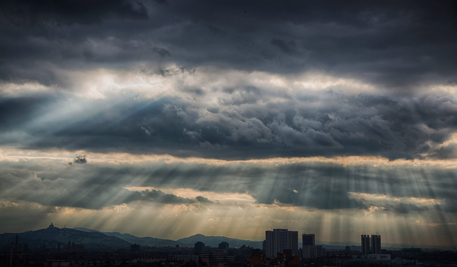 Rays of Hope Over Bologna, Italy