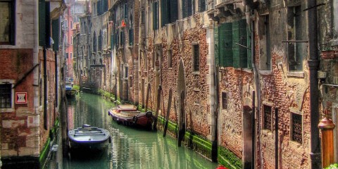 Lone Red Boat in Venice, Italy
