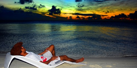 Man relaxing on a beach chair in Maldives