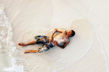 Man relaxing on beach in Maldives