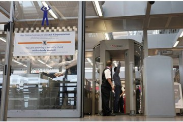 Passenger is checked with full body scanner at the security gate at the airport in Hamburg