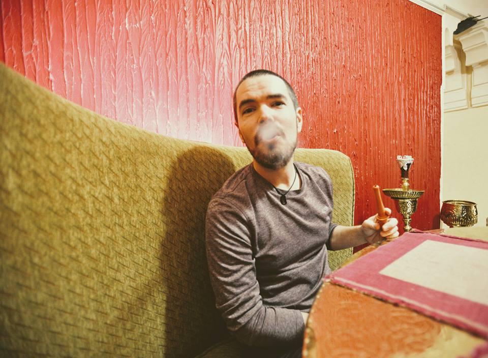 Mike smoking shisha at Naguib Mahfouz cafe in Cairo's Khan el Khalili Bazaar, Egypt