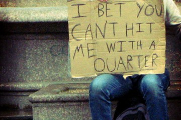 Boy with Sign: I Bet You Can't Hit Me with a Quarter