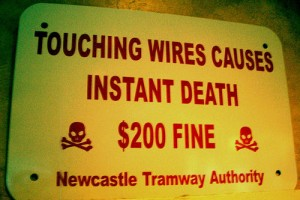 Sign: Touching Wires Causes Instant Death ($200 Fine), Newcastle