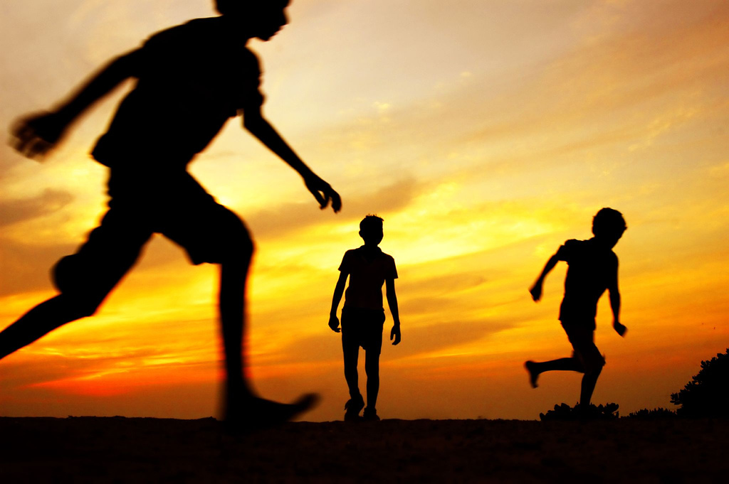Silhouette of children playing in Maldives