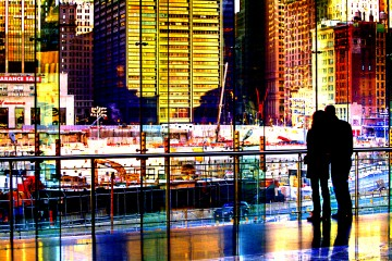 Silhouette of couple standing together, looking out at Manhattan, New York City