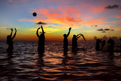 Silhouettes playing at the beach, Maldives