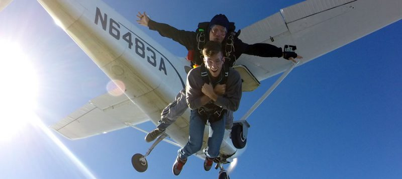 Two men tandem skydiving with Skydive Newport in Rhode Island