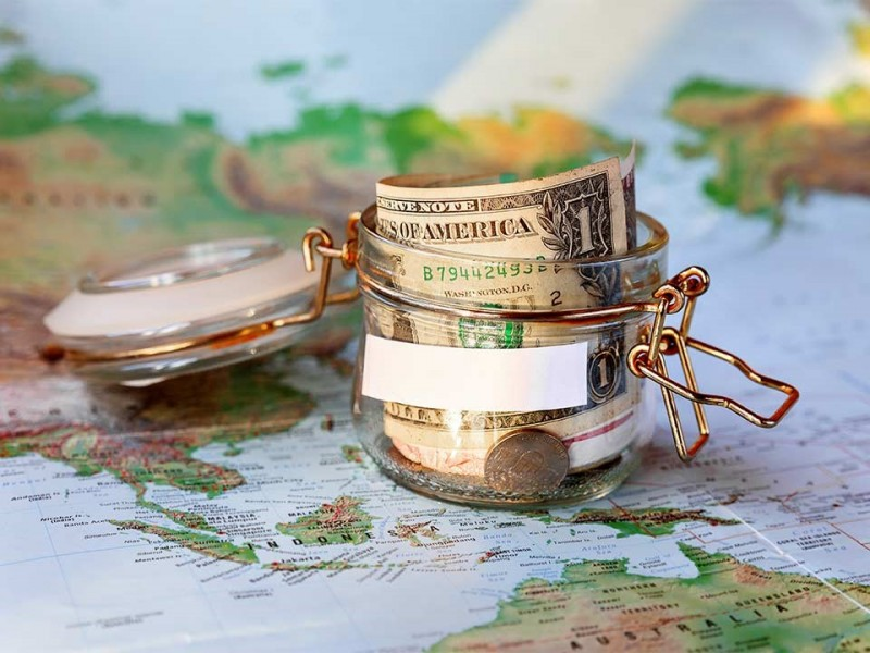 Small Money Jar on a World Map