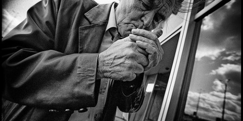 Old man smoking in Moscow, Russia