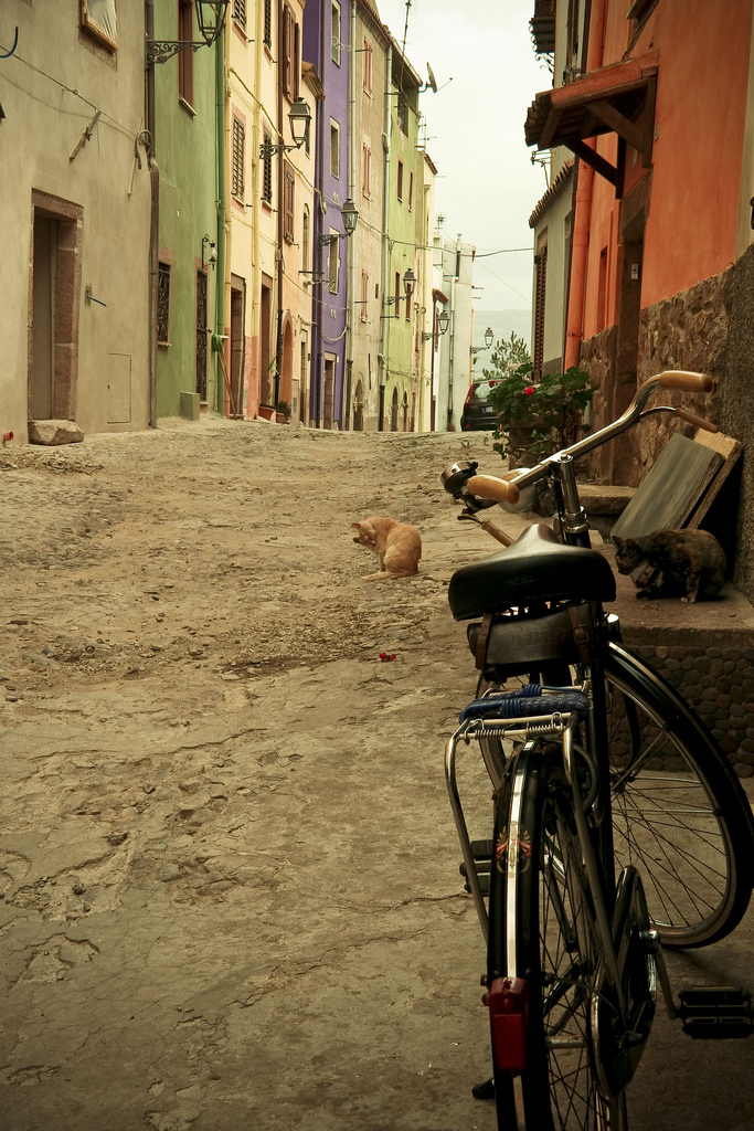 Bike in alley on streets of Alghero in Sardinia, Italy