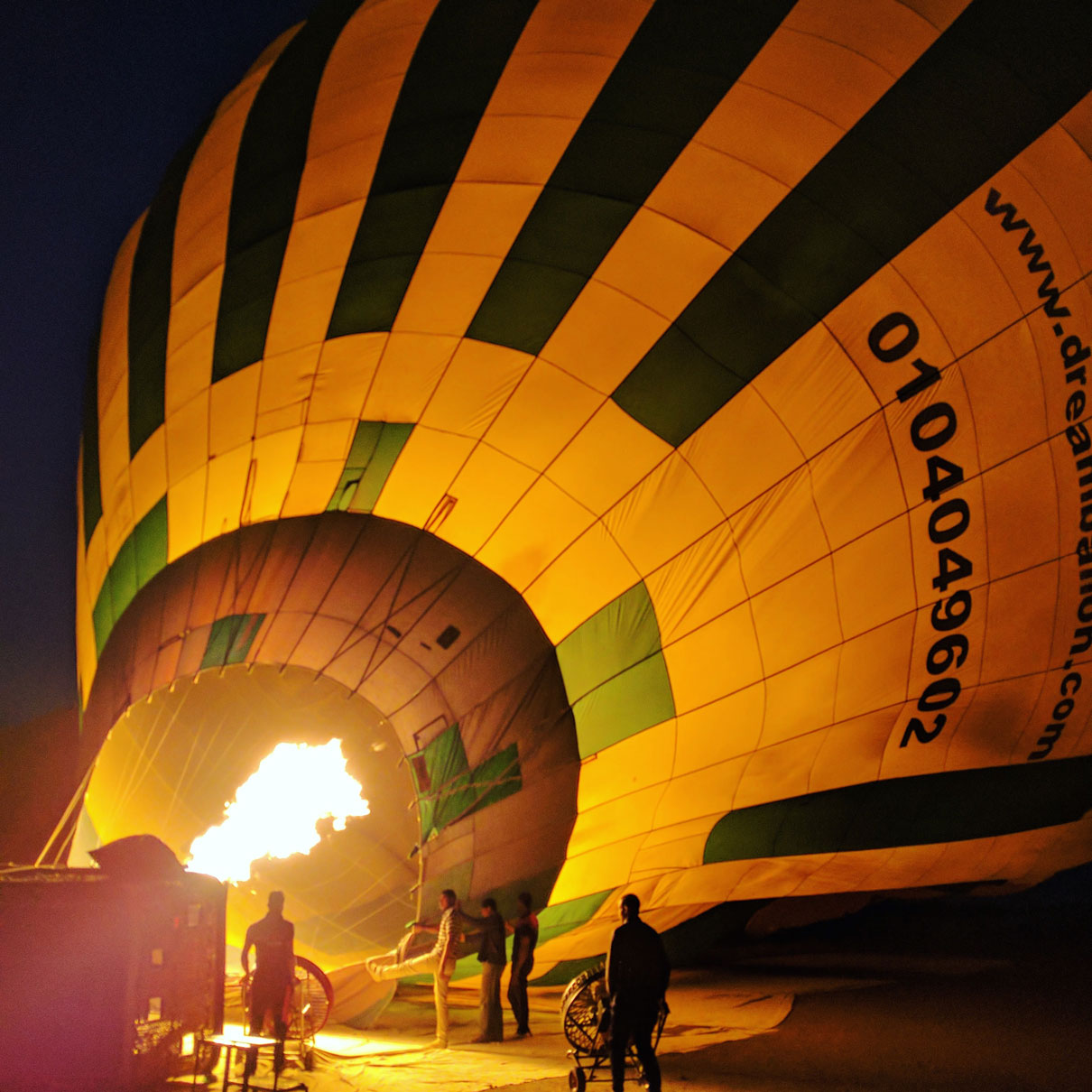 Team blowing up the hot air balloon before a sunrise flight over Luxor