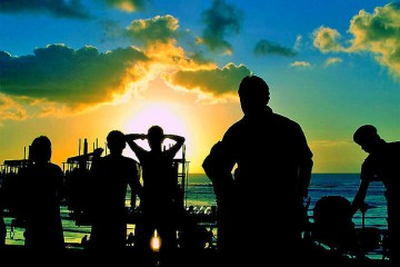 Silhouette of group watching sunset in Bali, Indonesia