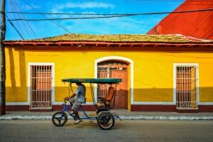 Taxi bike driving through Trinidad