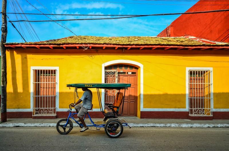 Taxi bike driving through Trinidad, Cuba