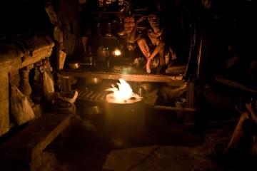 Tea Man Sitting Near Fire, India
