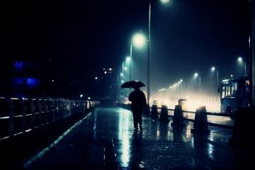 Man walking in rain in India