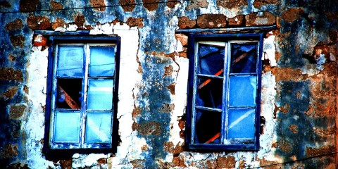 Two windows in an old building in Cyprus
