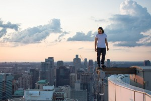 Man standing on an i-beam over edge of skyscraper