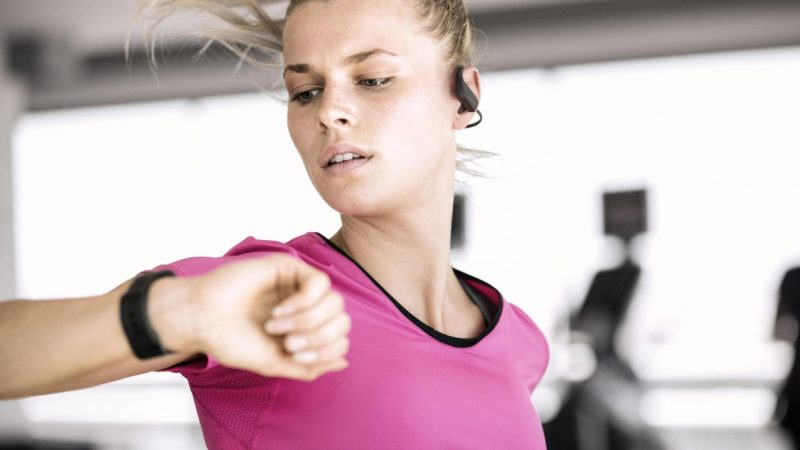 Girl working out with TomTom Spark 3 fitness tracker