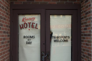 "Chicago hotel with ""Transients Welcome"" sign on door"