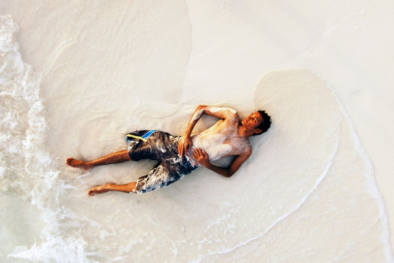 Traveler Relaxing on a Beach, Maldives
