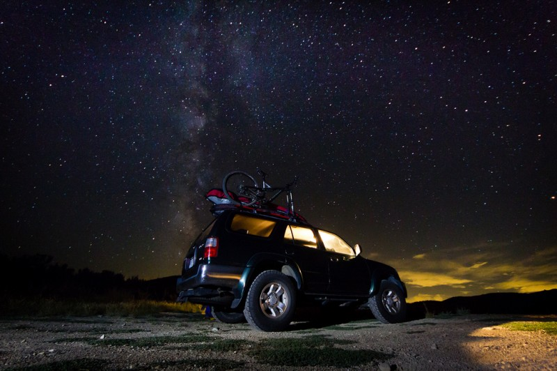 Truck parked at night with bright stars, Wyoming