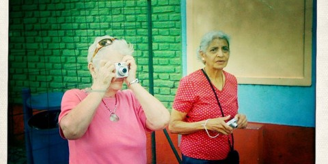Two Ladies Taking iPhone Photos