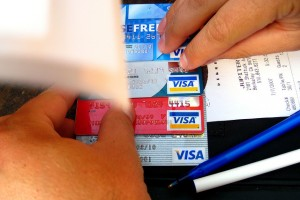 Hands holding stack of Visa credit cards