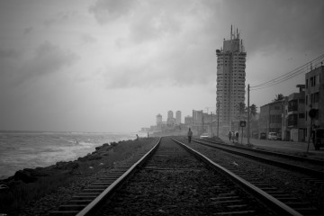 Walking the train tracks near Colombo, Sri Lanka