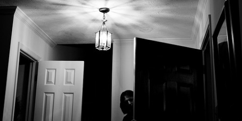 Woman behind door (black and white)
