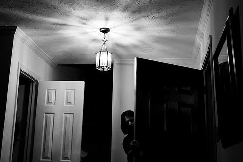 Woman behind door