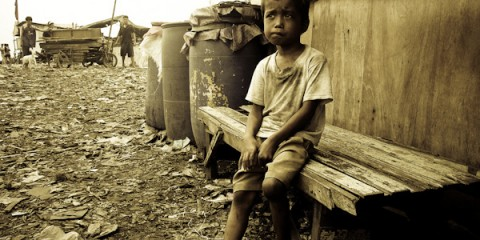 Boy on bench, pondering in Manila