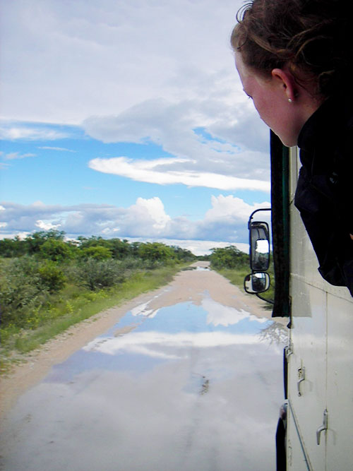 Girl with head outside bus window in Namibia