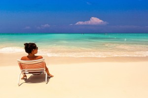Woman alone on the beach in Grace Bay, Turks & Caicos
