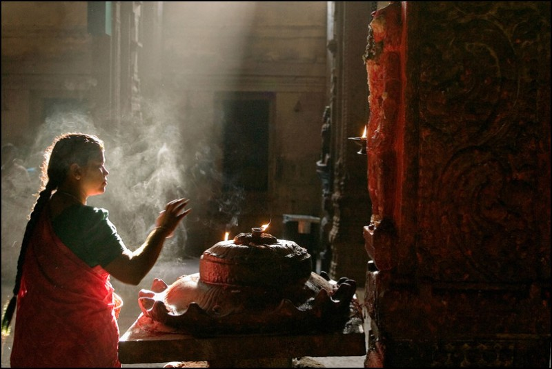 A woman praying Hanuman, the monkey god in the superb Meenaskshi temple, Madurai, India