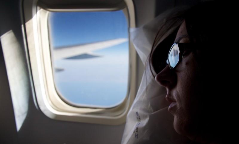 Woman sleeping on an airplane