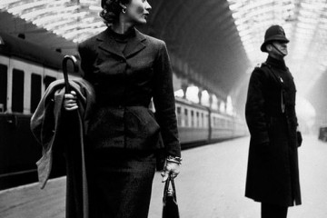 Woman walking through Victoria Station, London (1951)