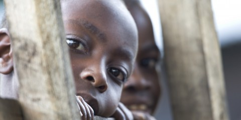 Two curious, eavesdropping boys in Congo