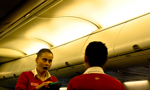 Funny capture of flight attendant making zombie-like face